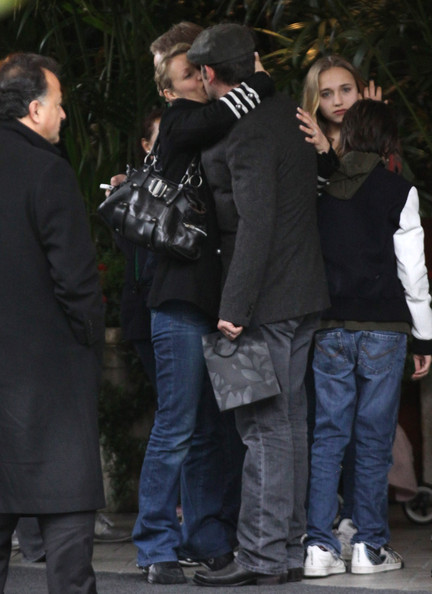 Jean dujardin photos jean dujardin exits his hotel with for Jean dujardin parents