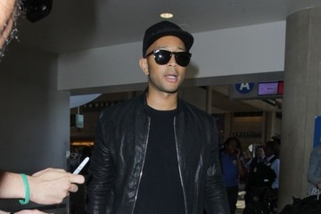 John Legend Chrissy Teigen and John Legend Depart on a Flight at LAX
