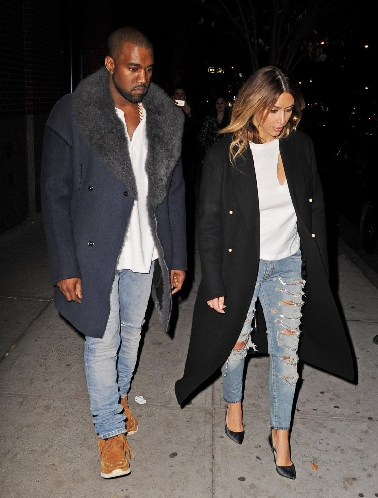 Reality star Kim Kardashian and her rapper fiance Kanye West head to Kanye's concert in New York City, New York on November 20, 2013.