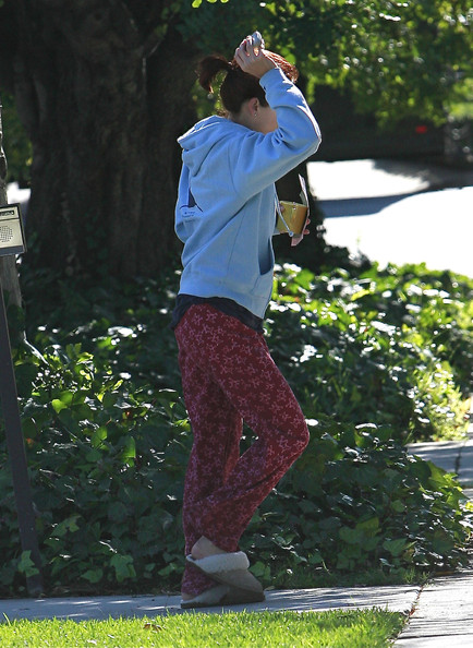 Kate Walsh In Pajamas Stepping Outside Her House