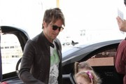 """American Idol' judge Keith Urban and his daughters Faith and Sunday departing on a flight at LAX in Los Angeles, California on March 7, 2014."