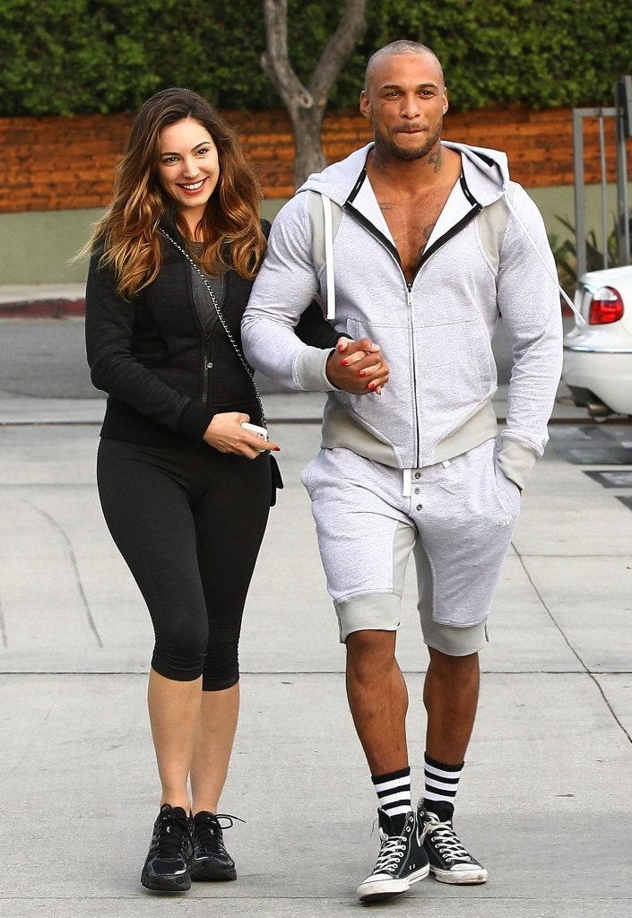 Danny who? Kelly Brook looks smitten with a mystery man in