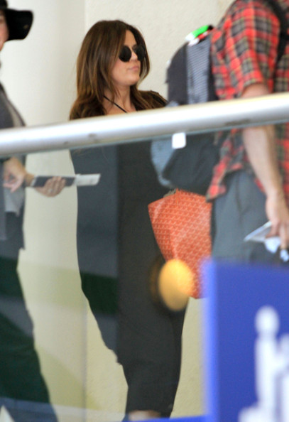 Khloe Kardashian Kim, Kourtney and Khloe Kardashian arriving for a flight at LAX airport in Los Angeles, CA.