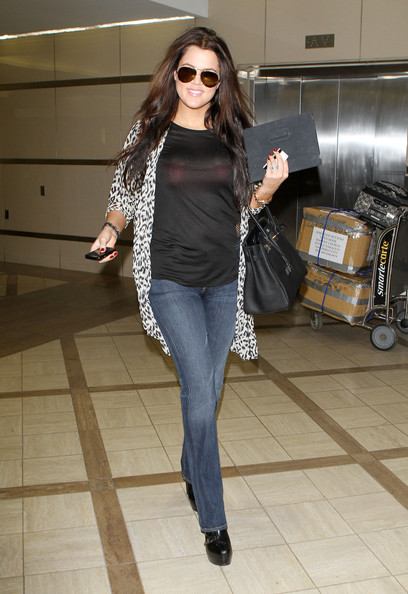 Khloe Kardashian Reality star Khloe Kardashian arrives at LAX airport to catch a flight to New York, perhaps to cheer on her husband Lamar Odom as the Lakers take on the New York Knicks tonight. The socialite's red bra could be seen through her see through black top.