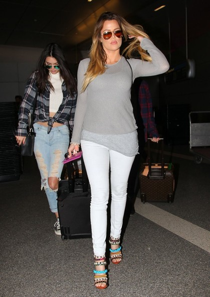 Kris and Bruce Jenner Hold Hands at LAX []