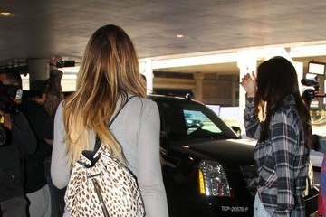 Khloe Kardashian Kris and Bruce Jenner Hold Hands at LAX