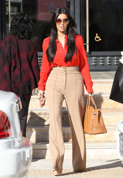 "Kim Kardashian TV personality Kim Kardashian showed off her assets in a tight pair of beige slacks while shopping with choreographer pal Robin Antin at Barneys New York in Los Angeles, California on January 12, 2012. Kim recently commented on the rumors that Khloe is not the biological daughter of Robert Kardashian saying that is ""Ridiculously false"" after a hair appointment yesterday."