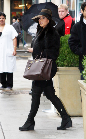 Kardashian and Scott Disick are seen leaving their new Dash clothing