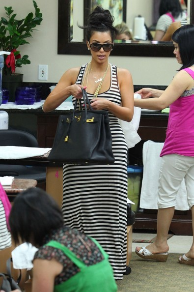 Reality star Kim Kardashian getting a pedicure at a nail salon in Beverly Hills, CA.