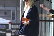 'Midnight Special' actress Kirsten Dunst goes to lunch with her mother Inez in West Hollywood, California on February 18, 2015. Kirsten wore a short navy blue skirt to show off her pasty white legs and a peacoat incase she got cold.