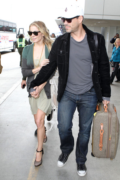 LeAnn Rimes Singer LeAnn Rimes and her fiance Eddie Cibrian arriving on a flight from Houston at LAX airport in Los Angeles, CA. LeAnn sung the National Anthem at the NCAA Men's Basketball Championship last night in Houston, TX.