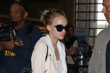 Lily-Rose Depp Vanessa Paradis Catches a Flight at LAX with Her Family