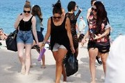 British girl group Little Mix enjoys a break from their tour with Demi Lovato to relax on the beach with friends on February 24, 2014 in Fort Lauderdale, Florida.