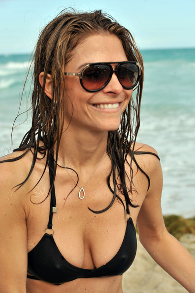 TV Host Maria Menounos wearing a skimpy black Vitamin A bikini on the beach ...