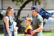 Actor Mark Wahlberg and wife watching their son's soccer game on May 21, 2016. Afterwards, Brendan left with a trophy from his game.