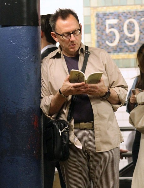 Michael Emerson Reads a Book While Waiting for the Train