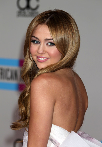 Miley Cyrus Celebrities arrive at the American Music Awards at the Nokia Theatre LA Live in Los Angeles.