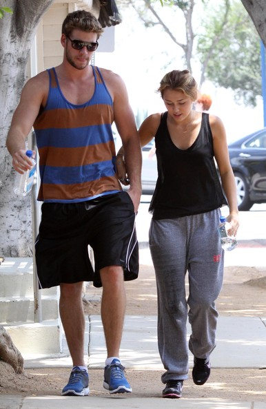 Miley Cyrus Actress Miley Cyrus and her boyfriend Liam Hemsworth seen leaving a gym after working out in West Hollywood, CA.