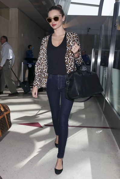 Model Miranda Kerr arrives at LAX Airport in Los Angeles on Friday, March 1, 2013 and graciously signs autographs before heading off.