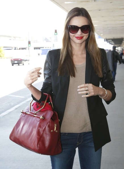 Former Victoria's Secret model Miranda Kerr arrives at LAX Airport to catch a flight on April 26, 2013 in Los Angeles, California.