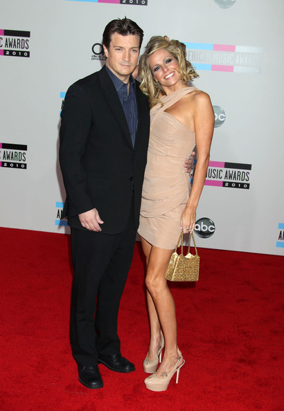 Nathan Fillion and his gorgeous date attend Snow Patrol performance at ...