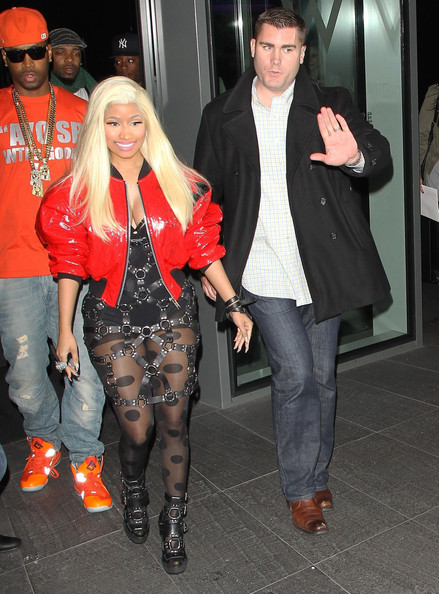 Outrageous rapper Nicki Minaj greets her fans as she leaves her hotel wearing a bondage style outfit on April 18, 2012 in London, UK.