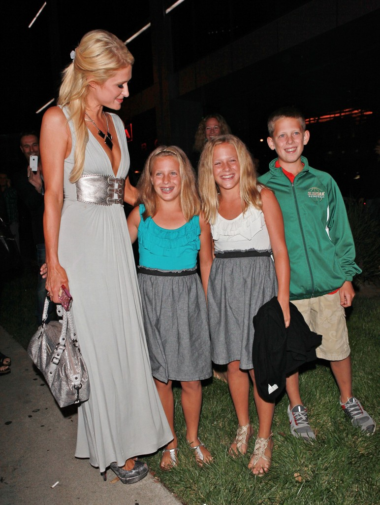 paris hilton takes time out of business dinner for young