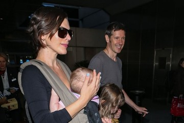 Paul W.S. Anderson Milla Jovovich and Family Arrive on a Flight at LAX
