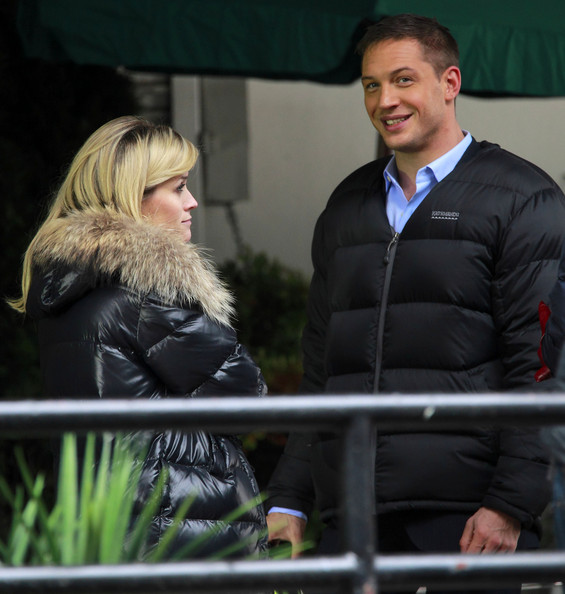 Actress Reese Witherspoon and Tom Hardy on the set of 'This Means War' in Vancouver, Canada. In between takes Director McG has a chat with them and then they share a group hug.