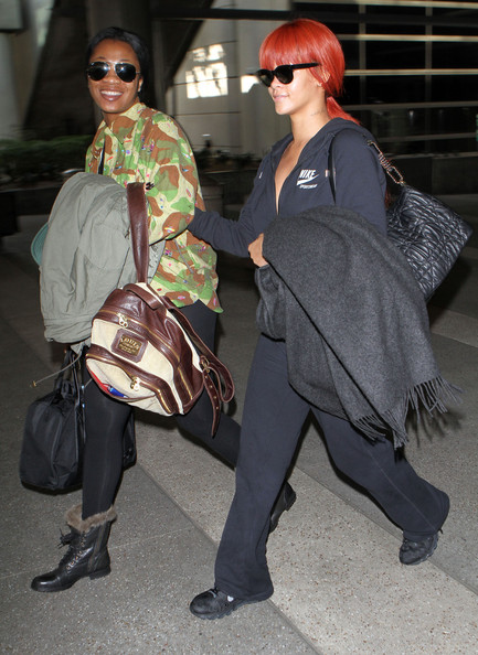 Rihanna Singer Rihanna arriving on a flight at LAX airport in Los Angeles, CA.