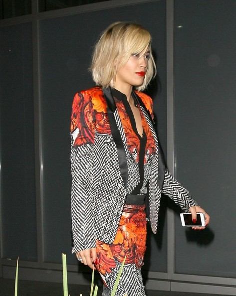 British singer Rita Ora wears a matching floral designed ensemble on her dinner date with Calvin Harris at Hakkasan restaurant on October 14, 2013 in Beverly Hills, California.