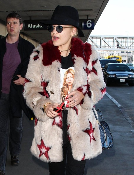 Rita Ora Touches Down at LAX []