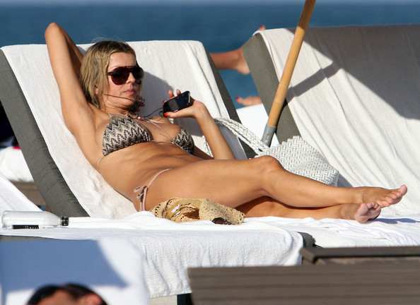 Producer Rita Rusic squeezed into a tiny bikini as she showed off her beach ...