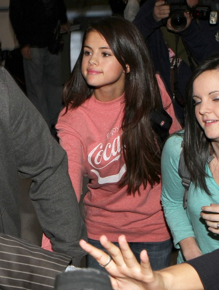 Selena Gomez Actress Selena Gomez is mobbed by photographers as she arrives at LAX airport to catch a flight out of Los Angeles.