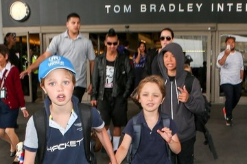 Shiloh Jolie-Pitt Brad Pitt and Angelina Jolie Arrive on a Flight at LAX With Their Kids