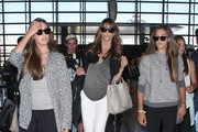 'Expendables 3' actor Sylvester Stallone, his wife Jennifer Flavin and their daughters Sophia, Sistine and Scarlet departing on a flight at LAX airport in Los Angeles, California on July 24, 2014. Sylvester will star in the upcoming movie 'Scarpa' where he will play hitman Gregory 'The Grim Reaper' Scarpa.