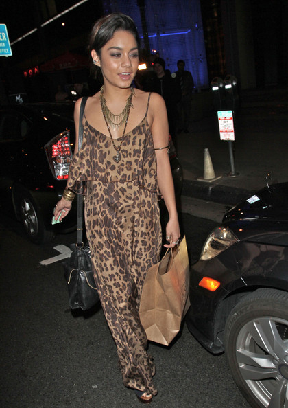 Actress Vanessa Hudgens takes her gal pal Brittany Snow out to BOA Steakhouse to celebrate her 25th birthday in West Hollywood. Vanessa continued her quest to bring back the 60s by wearing a backless leopard print jumpsuit.