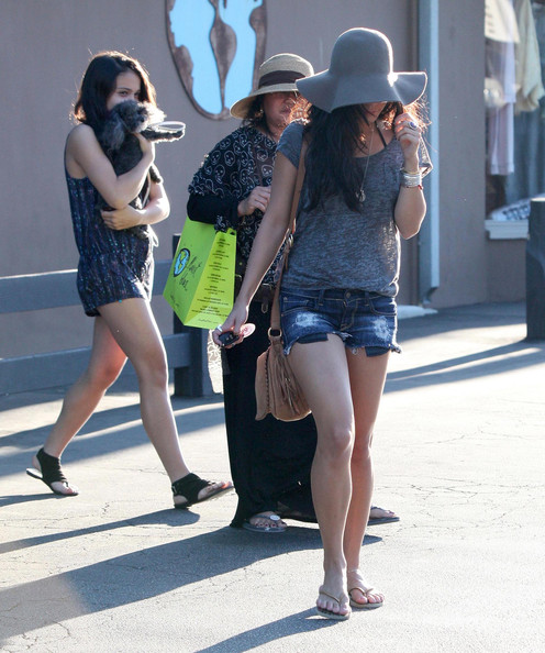 Vanessa Hudgens A shy Vanessa Hudgens covers her face with her hat as she walks back to her car after shopping at 'Plantet Blue' in Malibu with her mom and sister.