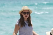Youtube Star Tanya Burr frolics at the beach with her friend in Miami on May 9, 2016.