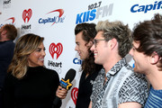 (L-R) TV personality Liz Hernandez and recording artists Harry Styles, Niall Horan and Louis Tomlinson.of music group One Direction attend 102.7 KIIS FMÂ's Jingle Ball 2015 Presented by Capital One at STAPLES CENTER on December 4, 2015 in Los Angeles, California.
