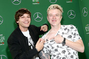 (EDITORIAL USE ONLY. NO COMMERCIAL USE.) (L-R) Louis Tomlinson and JoJo Wright attend 102.7 KIIS FM's Jingle Ball 2019 Presented by Capital One at the Forum on December 6, 2019 in Los Angeles, California.