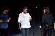 (L-R) Recording artists Louis Tomlinson, Liam Payne and Harry Styles of One Direction perform onstage during 102.7 KIIS FMÂ's Jingle Ball 2015 Presented by Capital One at STAPLES CENTER on December 4, 2015 in Los Angeles, California.