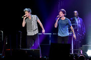 Recording artists Niall Horan (L) and Louis Tomlinson of One Direction perform onstage during 102.7 KIIS FMÂ's Jingle Ball 2015 Presented by Capital One at STAPLES CENTER on December 4, 2015 in Los Angeles, California.