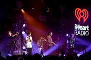(L-R) Singers Harry Styles, Louis Tomlinson, Liam Payne, and Niall Horan of One Direction perform onstage during 106.1 KISS FM's Jingle Ball 2015 presented by Capital One at American Airlines Center on December 1, 2015 in Dallas, Texas.