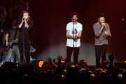 (L-R) Singers Harry Styles, Niall Horan, Louis Tomlinson, and Liam Payne of One Direction performs onstage during 106.1 KISS FM's Jingle Ball 2015 presented by Capital One at American Airlines Center on December 1, 2015 in Dallas, Texas.