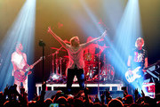 (L-R) Musicians Drew Stewart, Aaron Bruno, Isaac Carpenter and Duff McKagan of Awolnation perform onstage during 106.7 KROQ Almost Acoustic Christmas 2015 at The Forum on December 12, 2015 in Los Angeles, California.