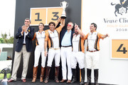 Veuve Clicquot President and CEO Jean-Marc Gallot, polo players Delfina Blaquier and Nacho Figueras, CEO of Moet Hennessy Philippe Schaus, and polo players Miguel Mendoza and Marcelo Amadeo Videla pose onstage after the 11th annual Veuve Clicquot Polo Classic at Liberty State Park on June 2, 2018 in Jersey City, New Jersey.