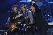 """Nils Lofgren, Bruce Springsteen, and Steven Van Zandt perform at """"12-12-12"""" a concert benefiting The Robin Hood Relief Fund to aid the victims of Hurricane Sandy presented by Clear Channel Media & Entertainment, The Madison Square Garden Company and The Weinstein Company at Madison Square Garden on December 12, 2012 in New York City."""