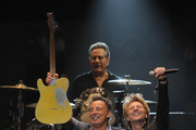 "Musicians Bruce Springsteen, Jon Bon Jovi and Max Weinberg perform at ""12-12-12"" a concert benefiting The Robin Hood Relief Fund to aid the victims of Hurricane Sandy presented by Clear Channel Media & Entertainment, The Madison Square Garden Company and The Weinstein Company at Madison Square Garden on December 12, 2012 in New York City."