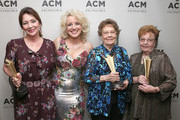 (L-R) Pam Miller, Cam, Bobbie Hedrick and Garneta Johnston take photos during the 12th Annual ACM Honors at Ryman Auditorium on August 22, 2018 in Nashville, Tennessee.